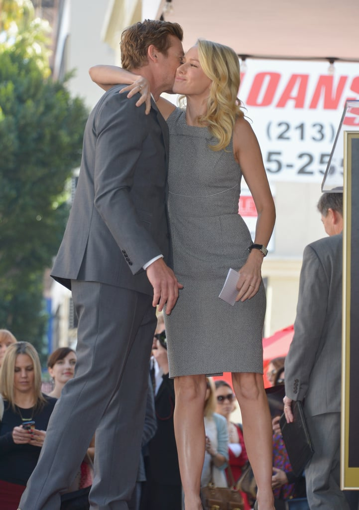 Naomi Watts kissed and congratulated good friend and former costar Simon Baker for his Hollywood star.