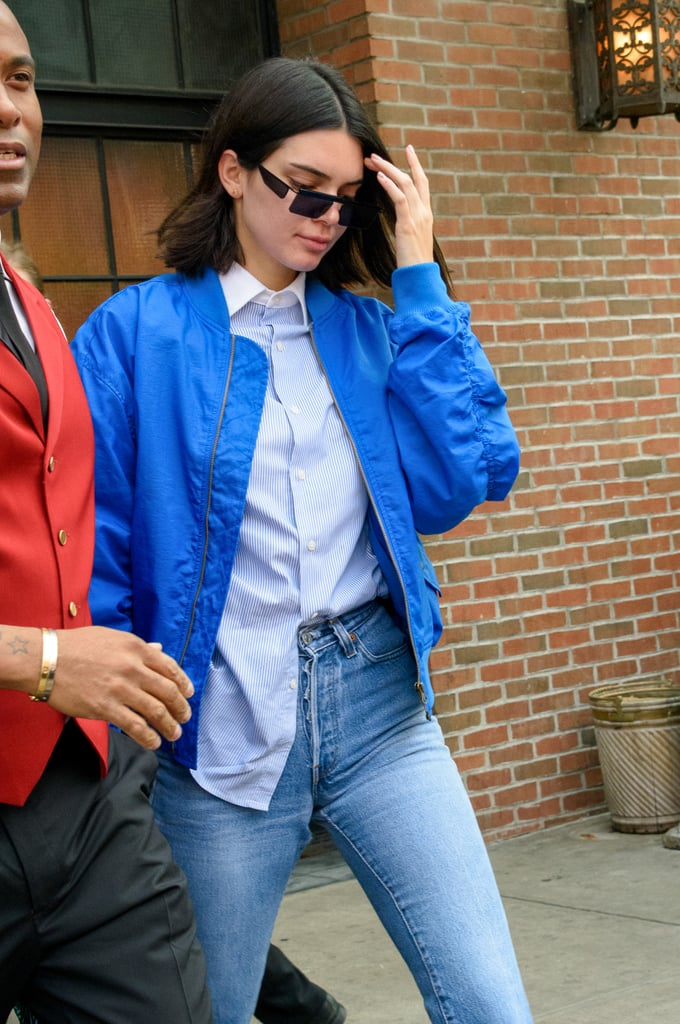Kendall Jenner Wore a Blue Bomber Jacket by Fiorucci With a Button-Down Shirt and High-Waisted Jeans