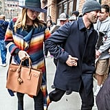 Rosie paired a colorblock fedora with a striped coatigan and Saint Laurent bag.