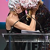 They shared a cheeky moment during the Crystal + Lucy Awards in June 2015.