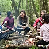Kate Middleton sat around a campfire with children from Expanding Horizons' primary school outdoor camp.