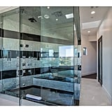 The master bathroom includes a steam shower, sauna, and infinity tub with views overlooking Beverly Hills. Talk about luxury.