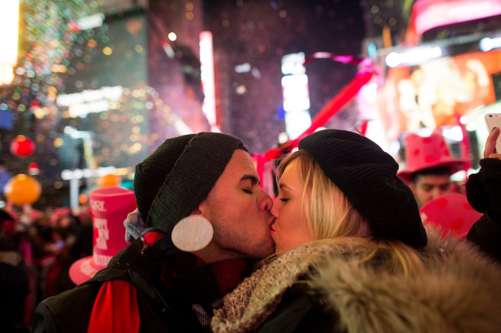 A loved-up couple shared a sweet kiss under confetti rain at midnight.
