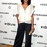 Jessica Szohr went easy-chic in a white blouse and wide-leg trousers.