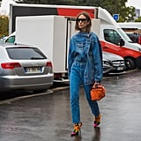 Haven't you heard? Everyone's rocking the denim on denim trend with a deconstructed twist. This street style star brought a pop of color to her look with Balenciaga floral sock booties.