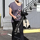 Charlize Theron ran errands in LA in this Junk Food Native vintage ($42) with black skinny jeans and red Toms flats.
