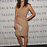 Her nude strapless cocktail dress got a fun update when added with two-tone heels — and the thick frames.