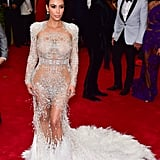 Kim Kardashian adorned her curves with feathers and embellishments in all the right places in her Roberto Cavalli gown.