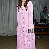 Dasha Zhukova sported a pink eyelet maxi dress with black sandals and a glittery purse at a Chanel event in Miami. Find a similar loose-fitting maxi dress so you can chow down without feeling uncomfortable.
