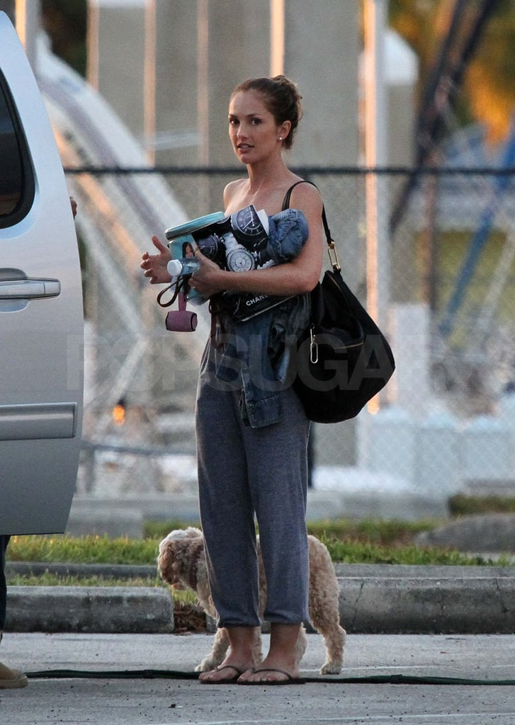 Minka Kelly Makes a Splash on Set With Her Pup by Her Side