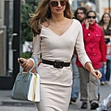 MIranda Kerr stepped out in a belted white dress in NYC.