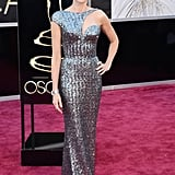 Best actress nominee Naomi Watts —mom to Sasha and Kai — wore Armani Privé on the red carpet at the Oscars.