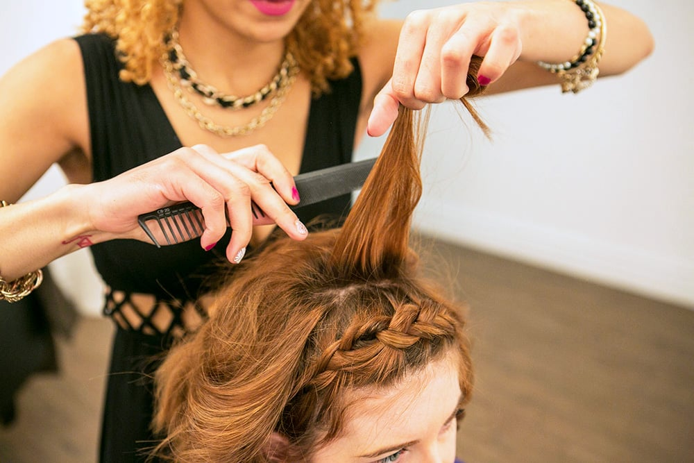 So your hair isn't just lying flat, go back and tease your hair at the crown for lift and shape. Don't forget to use a flat brush to smooth out the tease.