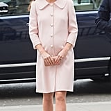 Kate wore a pearl-adorned Alexander McQueen coat while attending the Observance for Commonwealth Day Service in March 2015. It was a look she recycled from her first pregnancy, though this time around she complemented the outfit with a satin box clutch, powder-pink pumps, and a Jane Taylor headpiece.