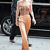For a dinner honoring Anna Wintour in June 2017, Gigi wore an embellished corset top with matching bronzed colored silk pants.