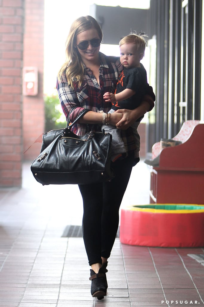 Hilary Duff carried her son, Luca Comrie, to class on Wednesday.