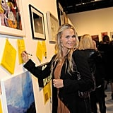 Newlywed Molly Sims bids on art for Livestrong.