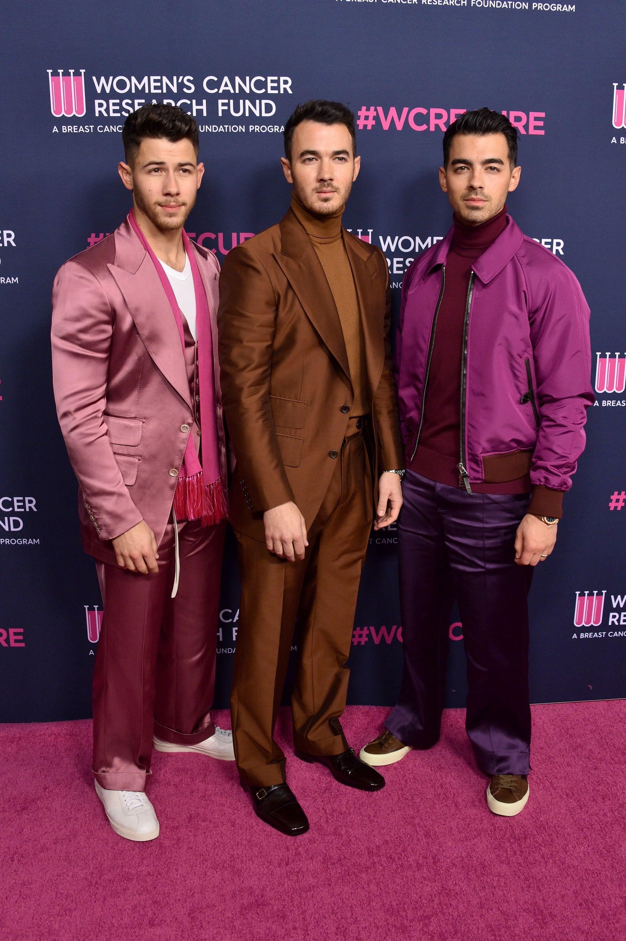 BEVERLY HILLS, CALIFORNIA - FEBRUARY 27: (L-R) Nick Jonas, Kevin Jonas, and Joe Jonas of The Jonas Brothers attend WCRF's