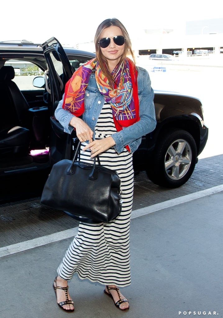 Miranda Kerr made a fashionable appearance at the LA airport donning a striped maxi dress and red silk scarf to depart the West Coast yesterday. She headed back to NYC for a special occasion, since her husband Orlando Bloom's Broadway play, Romeo and Juliet, will open in previews tomorrow night. Orlando attended a photocall with his onstage costar Condola Rashad to promote the revival of the Broadway classic in NYC two weeks ago. He's been busy with press for the play recently as he and Condola made a stop on Good Morning America yesterday as well. Miranda may also be reunited with her other main man, her son, Flynn Bloom, who she has spent a majority of her Summer hanging out with on the East Coast. Earlier this month, Miranda got an adorable kiss from Flynn as he accompanied her to a meeting in NYC.