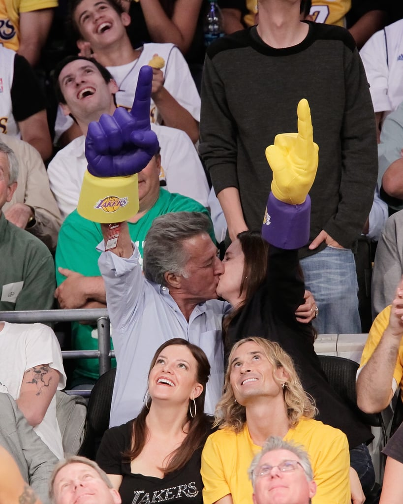 Dustin Hoffman and wife Lisa showed their Lakers pride as they kissed for the camera.