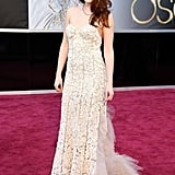 Kristen donned a pale blush Reem Acra gown featuring intricate lace detailing for the Oscars in February.
