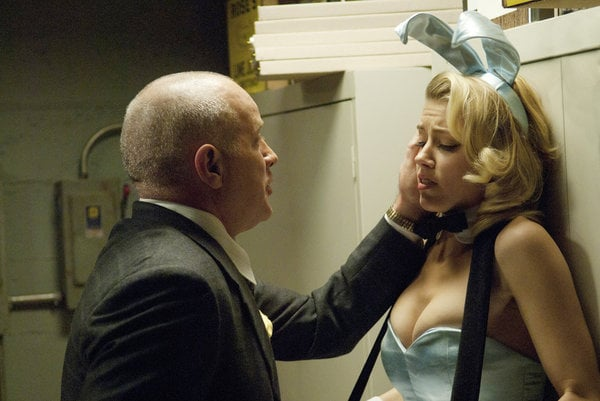 Randy Steinmeyer as Clyde Hill and Amber Heard as Maureen on NBC's The Playboy Club.