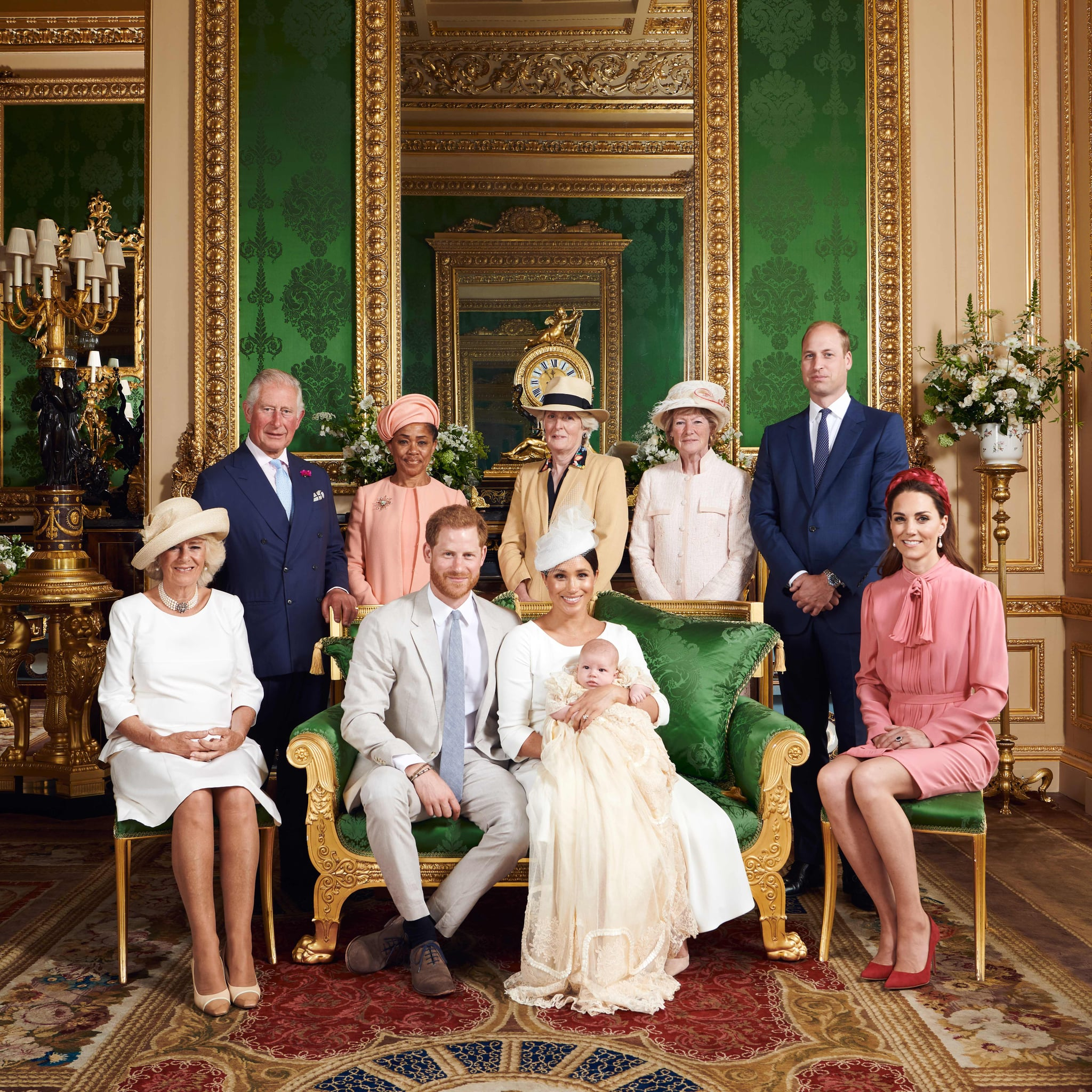 This official handout Christening photograph released by the Duke and Duchess of Sussex shows Britain's Prince Harry, Duke of Sussex (centre left), and his wife Meghan, Duchess of Sussex holding their baby son, Archie Harrison Mountbatten-Windsor flanked by (L-R) Britain's Camilla, Duchess of Cornwall, Britain's Prince Charles, Prince of Wales, Ms Doria Ragland, Lady Jane Fellowes, Lady Sarah McCorquodale, Britain's Prince William, Duke of Cambridge, and Britain's Catherine, Duchess of Cambridge in the Green Drawing Room at Windsor Castle, west of London on July 6, 2019. - Prince Harry and his wife Meghan had their baby son Archie christened on Saturday at a private ceremony. (Photo by Chris ALLERTON / SUSSEXROYAL / AFP) / XGTY / RESTRICTED TO EDITORIAL USE - MANDATORY CREDIT