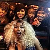 Nicki Minaj posed with a group of fans while inside her limo. Source: Twitter user NICKIMINAJ