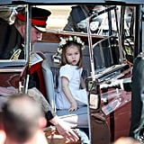 Princess Charlotte arrived at the 2018 wedding of Prince Harry and Meghan Markle in the back seat of a royal limo.