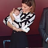 Queen Letizia cradled a tiny baby during a fundraising event in October.