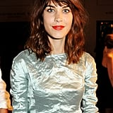 The always-chic Alexa Chung paired her auburn waves with a pop of red lipstick.
