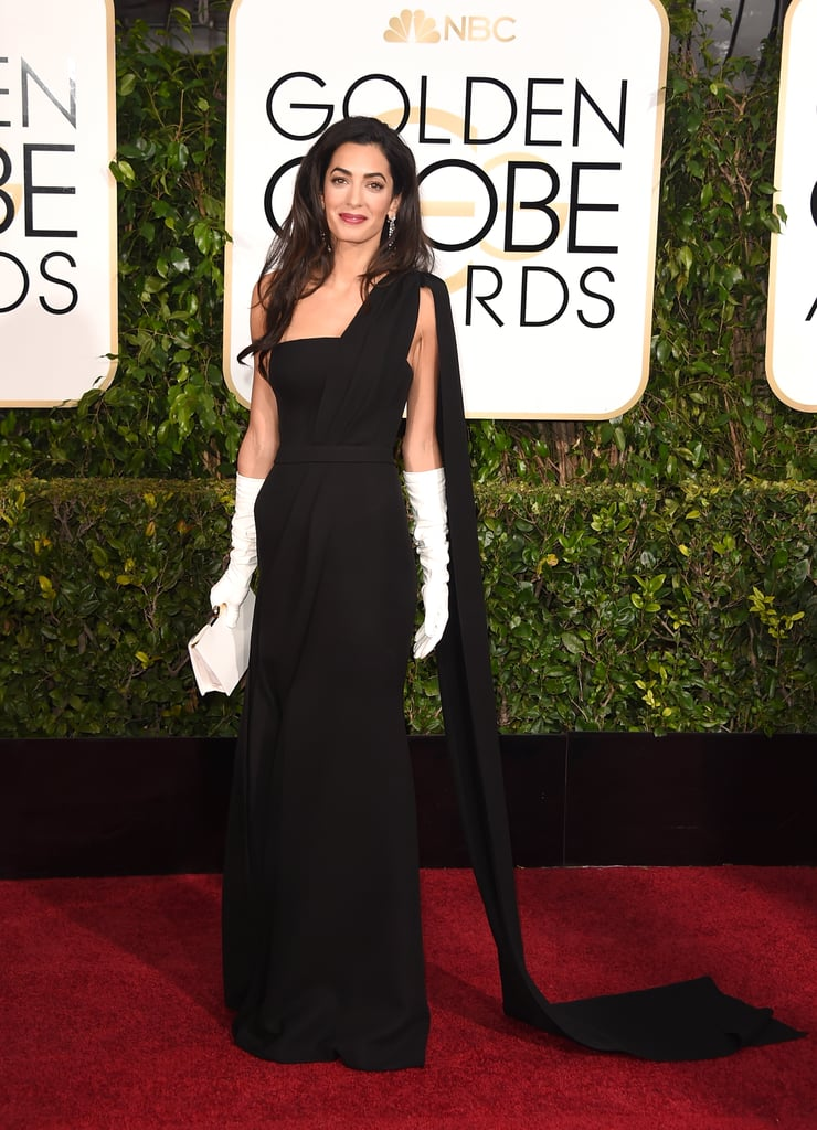 For the 2015 Golden Globe Awards, Amal wore a black Dior gown and ...
