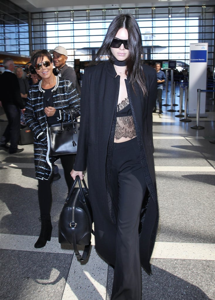 87613d2e33be2 Kendall stepped out at the airport in a lace bralette paired with ...