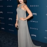 Following the unofficial dress code of the night, Camilla Belle wore a draped gray racerback gown by Gucci.