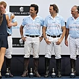 Prince Harry kisses Brazilian model Fernanda Motta as his team mate Calao Mello looks on after playing polo.