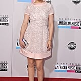 Ginnifer Goodwin donned a pale pink Oscar de la Renta mini at the American Music Awards this November.
