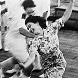 Princess Elizabeth plays tag onboard the HMS Vanguard in 1947