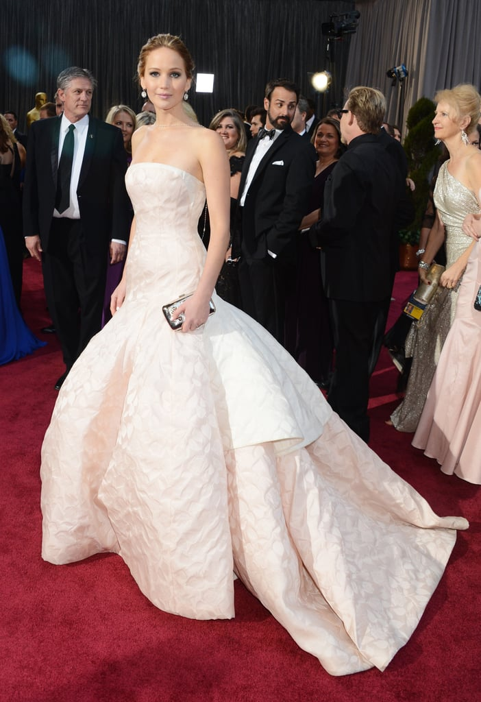 For the 85th Annual Academy Awards, Jennifer Lawrence made her mark on the red carpet in a strapless princess gown by Christian Dior Haute Couture.