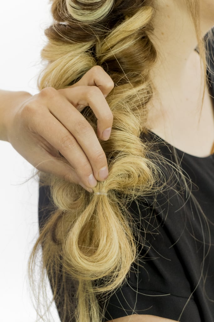 Take a low segment of this faux-braid, loop it up, and secure it with another elastic to make the style look messier and fuller.