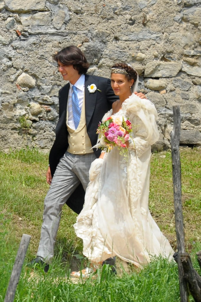 With her family's signature pattern on show from the guests, Italian fashion darling Margherita Missoni married her long-time beau, Eugenio Amos, in Brunello Italy yesterday. The bride looked whimsical, staying true to her bohemian style with silver sandals, and a bright bouquet and delicate headpiece. The dress spoke to her family's design aesthetic — original and creative — with an off-the-shoulder piece full of life and rufffles. The bridesmaids wore bright dresses and their own colourful veils, the smallest even sported one Margherita's signature fashion choices — the midriff top. Margherita is the eldest child of Angela Missoni, and her grandparents founded the iconic brand. Friends and family were in attendance, including the likes of Anna Dello Russo who tweeted a picture of her amazing outfit for Margherita's big day. Click through to see the beautiful pictures.