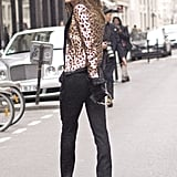 Anna Dello Russo was all smiles in a bold mix in leopard and a wide-brimmed hat.