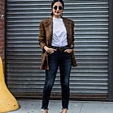 The Fall uniform we spot on fashion girls everywhere involves three pieces: a blazer, a t-shirt, and jeans. Accessorize to your taste either with jewelry or a belt to make the look your own.