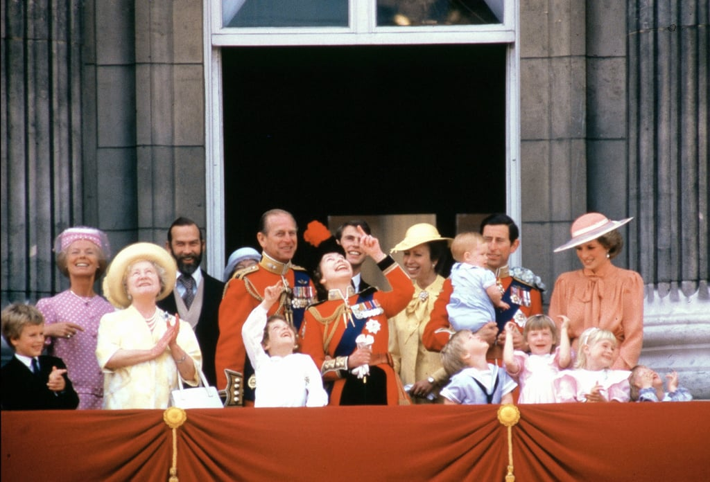 Princess Diana glanced at Prince William as she and the royal family watched the Trooping of the Colour from the Buckingham Palace balcony in June 1985.