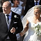 Zara Phillips and her husband, Mike Tindall, walk hand in hand.
