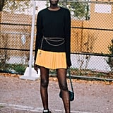 Tone down a colorful miniskirt with neutral extras.
