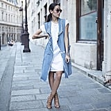 A T-Shirt Dress, Long Vest, and Heeled Sandals