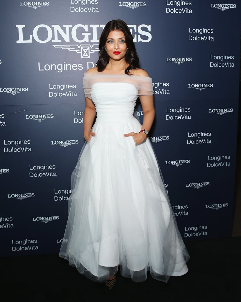 Looking ethereal in a white tulle off-the-shoulder gown by Toni Maticevski.