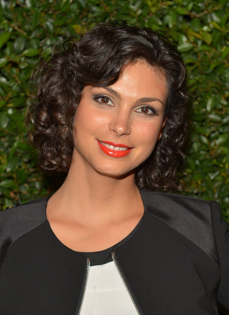 Morena Baccarin paired her curly bob with a tangerine lip and a subtle golden smoky eye.