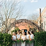 These bridesmaids wore gray gowns with intricate white lace tops.