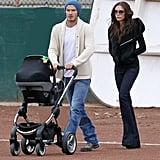 David Beckham pushed Harper in her stroller, while Victoria Beckham followed closely behind.